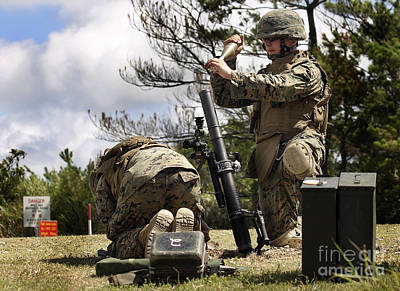 A Soldier Loads A High Explosive Mortar Poster by Stocktrek Images