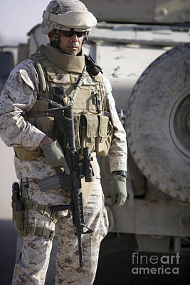 A Soldier Stands Alert As He Provides Poster by Stocktrek Images
