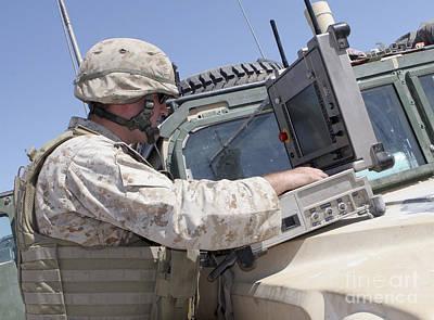 A Technician Navigates A Robot Using Poster by Stocktrek Images