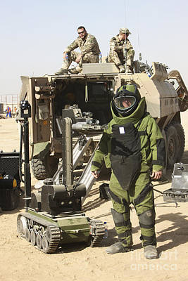 A U.s. Marine Dressed In A Bomb Suit Poster