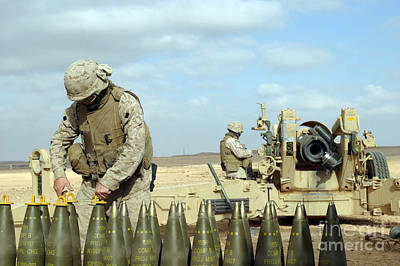 A U.s. Marine Prepares Howitzer Rounds Poster by Stocktrek Images