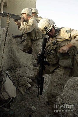 A U.s. Marine Reaches For More Rounds Poster by Stocktrek Images