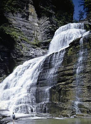 A Woman Is Dwarfed By Lucifer Falls Poster