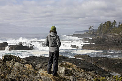 A Woman Stands On A Rocky Outcropping Poster by Taylor S. Kennedy