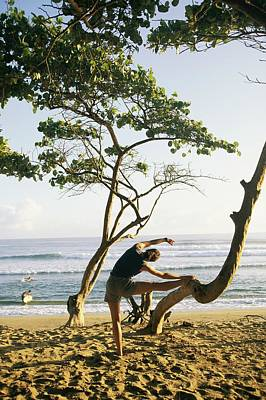 A Woman Stretches On A Beach Poster