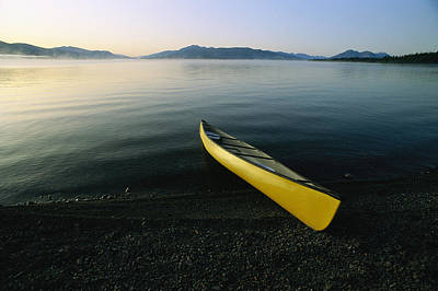 A Yellow Canoe On The Shore Of A Calm Poster by Michael Melford