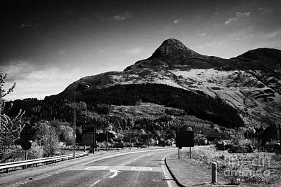A82 Road Into Glencoe With The Pap Of Glencoe In The Highland Of Scotland Uk Poster by Joe Fox
