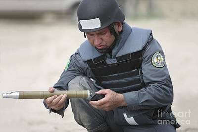 Afghan Police Student Prepares Poster by Terry Moore