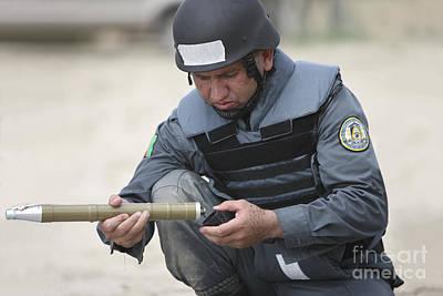 Afghan Police Student Prepares Poster
