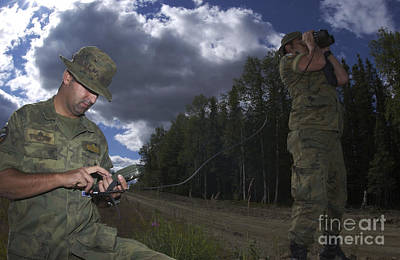 Airmen Use A Range Finder And Gps Unit Poster by Stocktrek Images