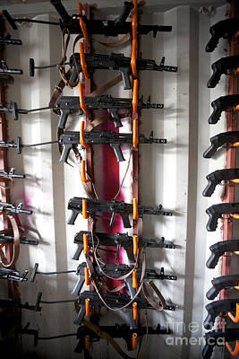 Akm Assault Rifles Lined Up On The Wall Poster