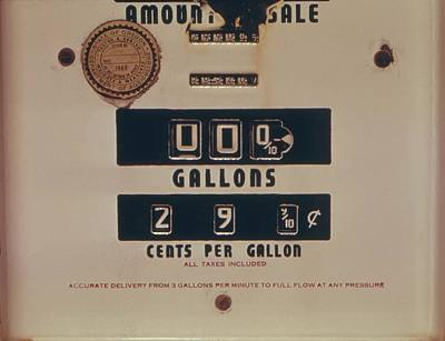 An Abandoned Gasoline Pump With A Price Poster by Everett