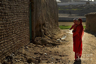 An Afghan Girl Carries Her Little Poster