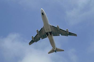 An Airplane Arrives At Ronald W. Reagan Poster by Joel Sartore
