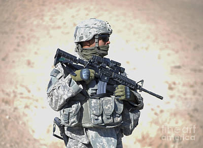An Army Soldier Stands Guard While Poster