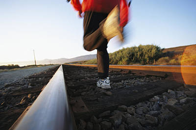 An Athlete Runs On Railroad Tracks Poster