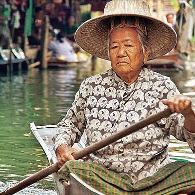 An Elderly Lady Rowing Along The Poster