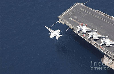 An Fa-18 Hornet Flys Over Aircraft Poster