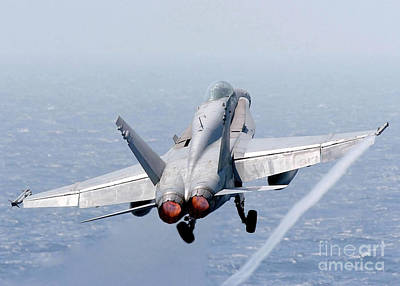An Fa-18 Hornet Taking Off Poster