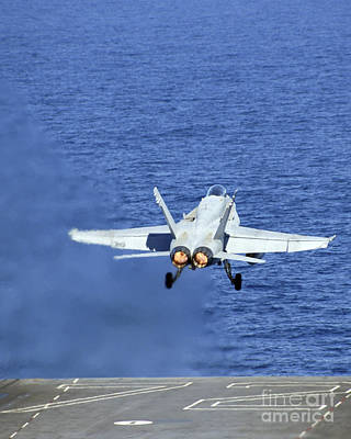 An Fa-18c Hornet Launches From The Uss Poster by Stocktrek Images