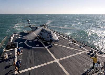 An Sh-60b Sea Hawk On The Flight Deck Poster