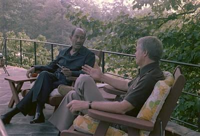 Anwar Sadat And Jimmy Carter At Camp Poster by Everett