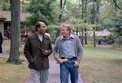 Anwar Sadat And Jimmy Carter Walking Poster by Everett