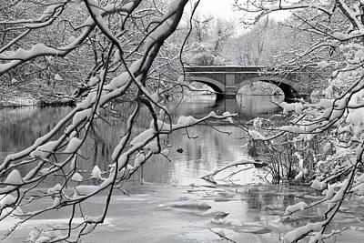 Arch Bridge Over Frozen River In Winter Poster