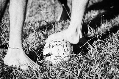 Argentinian Hispanic Men Start A Football Game Barefoot In The Park On Grass Poster by Joe Fox