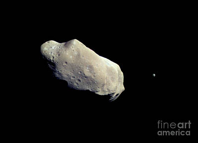Asteroid 243 Ida And Its Moon Dactyl Poster by Stocktrek Images