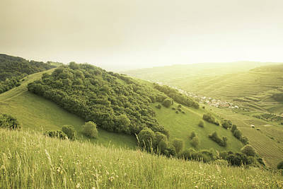 Beautiful Green Hills At Sunset Poster by Photo by Steffen Egly