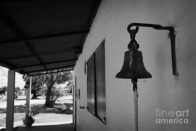 bell outside a small historic typical farm in Colonia Del Sacramento Uruguay South America Poster