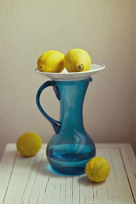 Blue Pitcher With Lemons On White Plate Poster by Copyright Anna Nemoy(Xaomena)