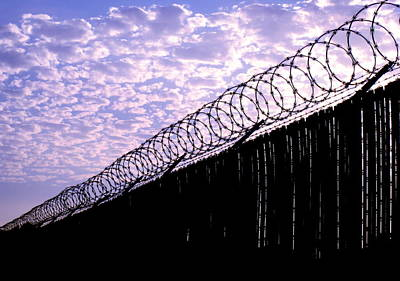 Blue Sunset And Barbed Wire Poster