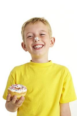 Boy Eating A Doughnut Poster by Ian Boddy