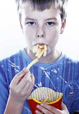 Boy Eating French Fries Poster by Kevin Curtis
