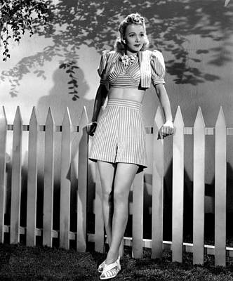 Carole Landis Modeling Striped Shorts Poster by Everett