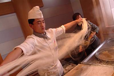 Chef Stretches Dough As He Makes Fresh Poster