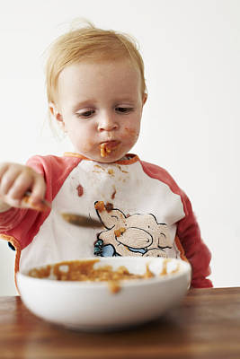 Child Eating Dinner Poster by Ian Boddy