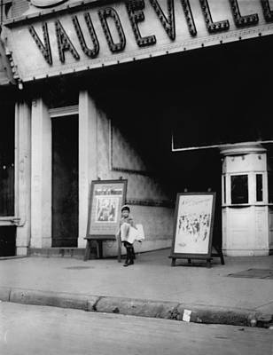 Child Labor In Front Of A Movie Poster