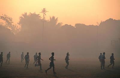 Children Playing Soccer At Sunset, Tha Khaek, Khammuan, Laos, South-east Asia Poster by John Elk III