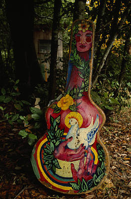 Close View Of A Decorated Guitar Case Poster by Phil Schermeister