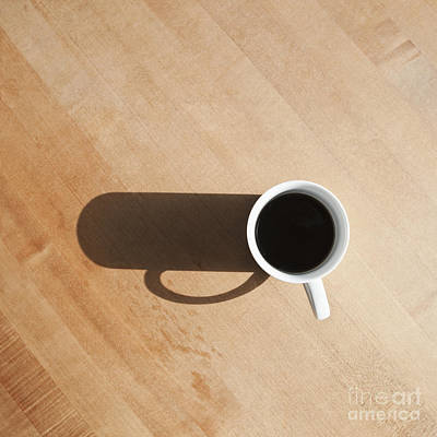 Coffee Cup And Shadow On A Table Poster