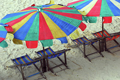 Colourful Deck Chairs And Umbrellas In Thailand Poster by Thepurpledoor