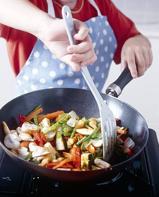 Cooking A Stir Fry Poster by Veronique Leplat