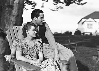 Couple Relaxing On Deckchair In Garden, (b&w) Poster