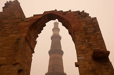 Cross Section Of The Qutub Minar Framed Within An Archway In Foggy Weather Poster