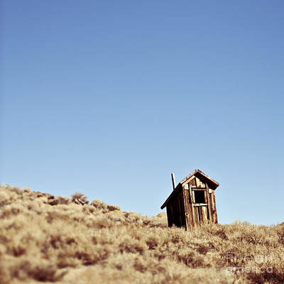 Dilapidated Outhouse On Hillside Poster