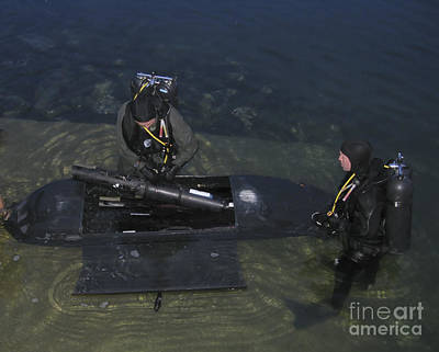 Divers Load Equipment Into Their Seal Poster by Michael Wood