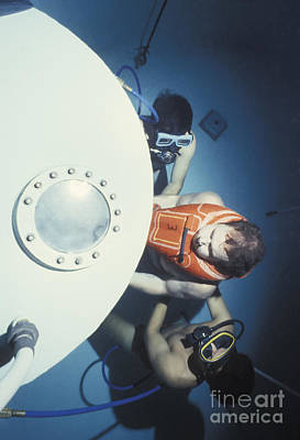 Diving Bell Instructors Hold Poster by Michael Wood